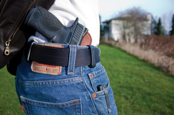 Pistol in holster inside jeans